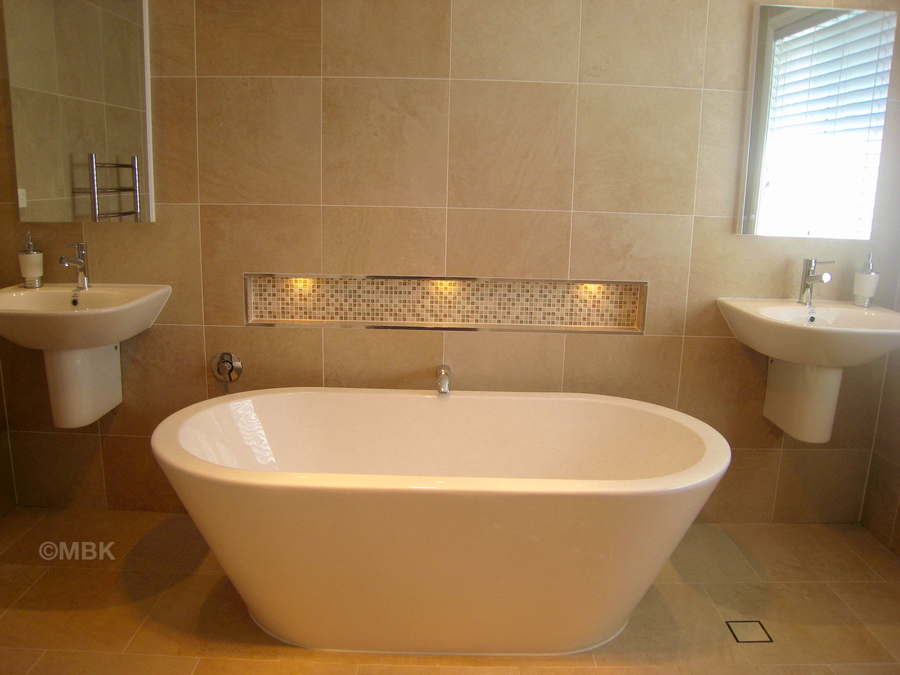 Bathroom with free standing bath and niche with down lights